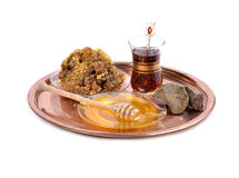 Honey on plate ,cup of Turkish tea Royalty Free Stock Images