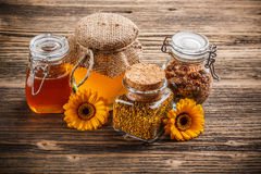 Honey, pollen and propolis. In glass jar Royalty Free Stock Photo