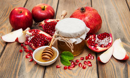 Honey with pomegranate and apples Royalty Free Stock Images