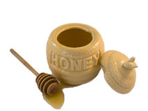 Honey pot. Wit a honey spoon on a white background Royalty Free Stock Image