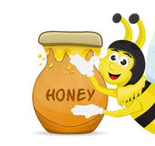Honey pot and bee Royalty Free Stock Photography