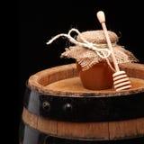 Honey pot and honey stick Royalty Free Stock Photography