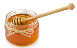 Honey pot on isolated white background Royalty Free Stock Images