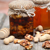 Honey in the pot and nuts Royalty Free Stock Image