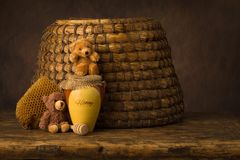 Honey pot and old beehive stock photo