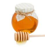 Honey pot and stick Stock Photos