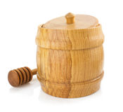Honey pot and stick on white Royalty Free Stock Images