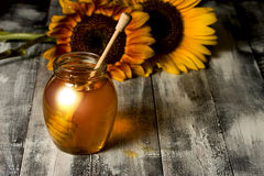 Honey Pot and Sunflowers Royalty Free Stock Image