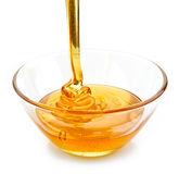 Honey pouring into bowl Stock Photos