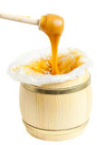 Honey pouring from drizzler Stock Images