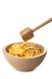 Honey pouring over cornflakes isolated Stock Photos