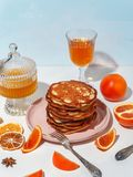Honey pouring over a stack of mini pancakes. The concept of a delicious breakfast stock images