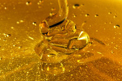Honey Pouring Waves. Closeup Golden Honey Pouring Waves Stock Image