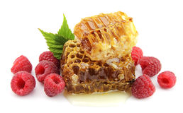 Honey and raspberries Stock Images