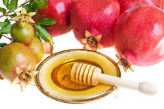 Honey  and ripe  pomegranates with leaves Stock Photography