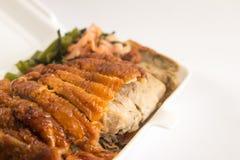 Honey roasted duck in foam box closeup Stock Photo