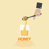 Honey's Jar With Drip In Hand. Stock Image