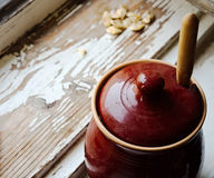Honey and seeds. Honey pot and seeds in rural style stock photos