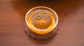 Honey. In a small glas bowl Stock Photography