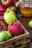 Honey Spas. Wooden box with the harvest of apples and honey for the holiday apple spas.Photo tinted Stock Photo