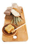 Honey, spike and bread on table Stock Image