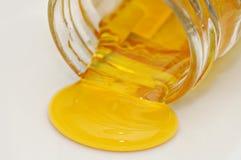 Honey spilling Royalty Free Stock Image