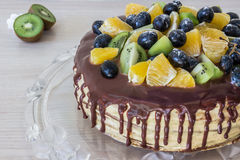 Honey sponge cake with fruits and chocolate stains Royalty Free Stock Photos