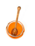 Honey spoon. And the jar on white Royalty Free Stock Image
