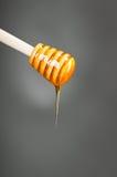 Honey spoon Royalty Free Stock Photos