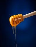 Honey spoon Stock Photo