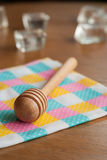 Honey spoon on a wooden table Stock Images
