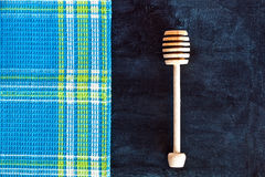 Honey stick and tablecloth Royalty Free Stock Photos