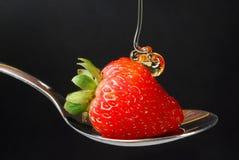 Honey and strawberry Royalty Free Stock Photos