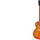 Honey sunburst vintage electric guitar on the right side of white background, with plenty of copy space. Royalty Free Stock Images