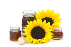 Honey and sunflowers Stock Image