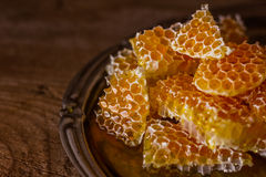 Honey. Sweet honeycombs with honey,wooden background Stock Photography