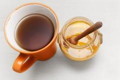Honey and tea Stock Image