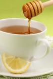 Honey tea with lemon. Healthy tea with honey and slice of lemon Stock Image