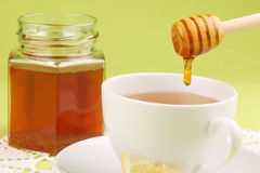Honey tea with lemon Stock Photos