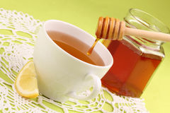 Honey tea with lemon. Healthy tea with honey and slice of lemon Royalty Free Stock Images