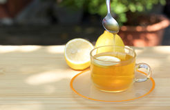 Honey tea with lemon. On wooden table Royalty Free Stock Images