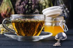 Honey with tea on rustic table backgound with herbs Royalty Free Stock Photography