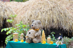 Honey teddy bear and friends. Teddy bear selling honey along with his little friends: another bear and a bee Stock Photo