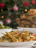 Honey and Thyme Roasted Parsnips and Baby Carrots. On a table Royalty Free Stock Images