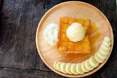 Honey Toast with Banana and Vanilla Ice Cream on Wooden Salver. Close Up Bread Buttered Toast with Whipped Cream Dessert on Wood D. Ish Background Great for Any Stock Photography