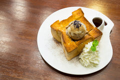 Honey toast with chocolate ice cream , maple syrup and sugar Royalty Free Stock Images