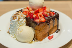 Honey Toast with chocolate lava and strawberry Royalty Free Stock Photos