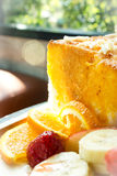 Honey toast with fresh fruit on wooden plate. Stock Photography