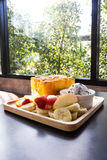 Honey toast with fresh fruit on wooden plate. Stock Image