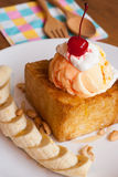 Honey toast with ice-cream and banana Royalty Free Stock Image